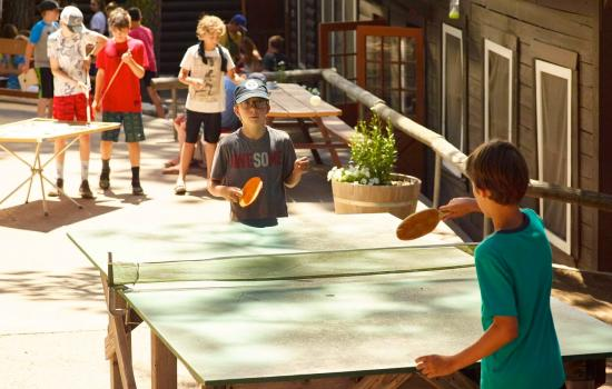 campers playing ping pong