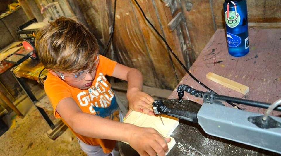 campers learn their way around the camp woodshop