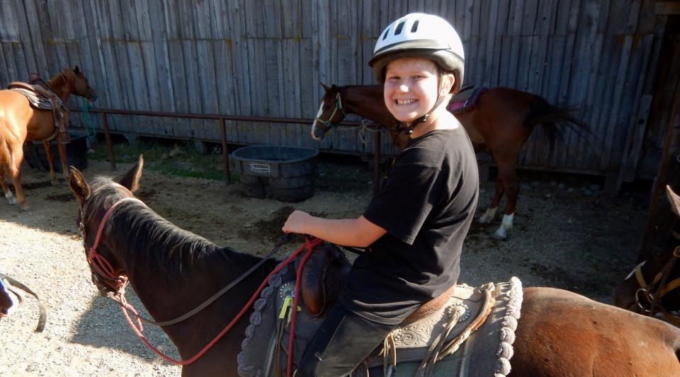 horseback riding at Walton's Grizzly Lodge summer camp