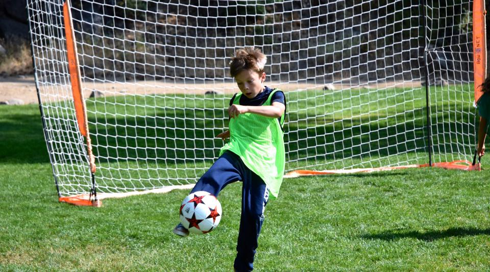 campers practice soccer skills at summer camp