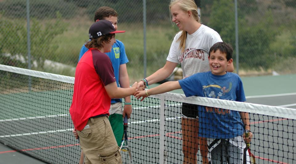 playing tennis at summer camp