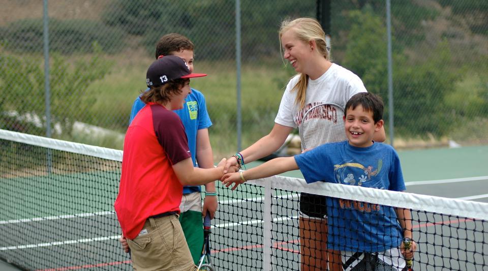 playing tennis at summer camp