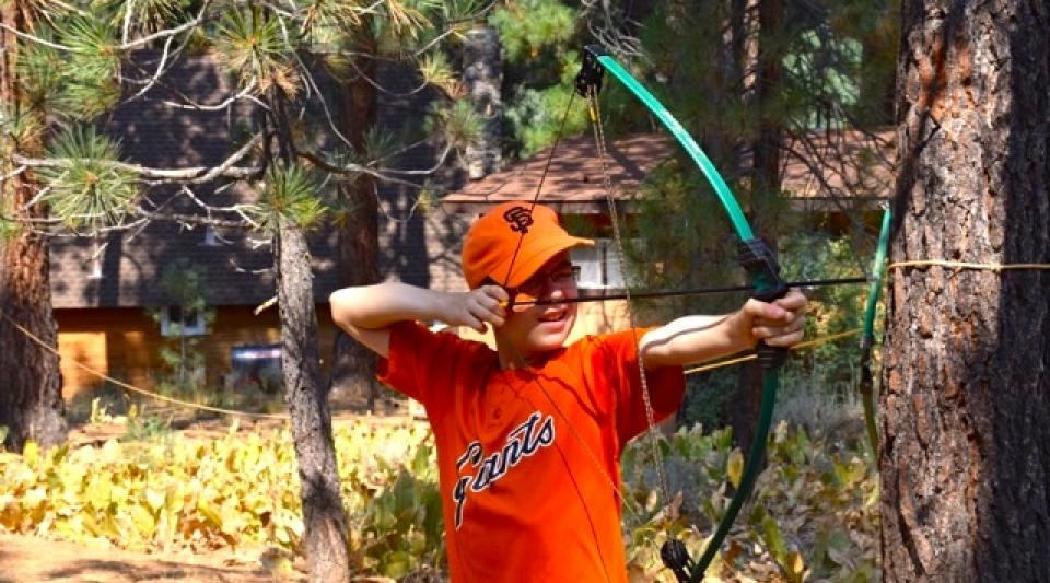 learning the basics of archery at grizzly lodge