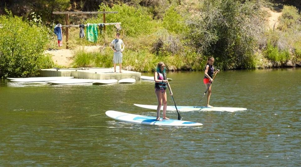 stand up paddle boarding at summer camp