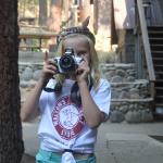 Campers taking photos at Walton's Grizzly Lodge