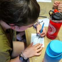 making arts and crafts for mom at summer camp